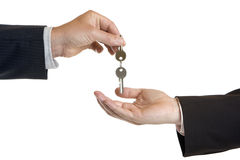 Handing over of house keys. One male hand give another male hand keys Royalty Free Stock Images