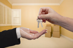 Handing Over the House Keys Inside Empty Room Stock Photo