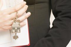 Handing over house keys Stock Images