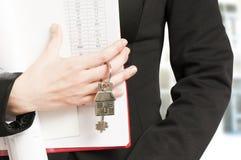 Handing over house keys Royalty Free Stock Image