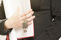 Handing over house keys Royalty Free Stock Photos