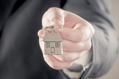 Handing over house keys Royalty Free Stock Photo