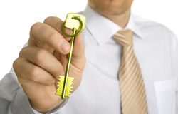 Handing over the key. Close-up Stock Image