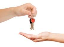 Handing over keys. Isolated on white Stock Images