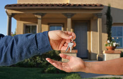 Handing Over the Keys. To A New Home Royalty Free Stock Image
