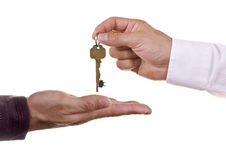 Handing over keys. Estate agent handing over house keys stock photo