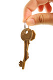 Handing over keys. Of success Stock Photography