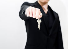 Handing over keys. Business man handing over keys Royalty Free Stock Photos