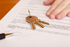Handing over of keys after contract signing. Of house sale. Isolated on white background Stock Photos