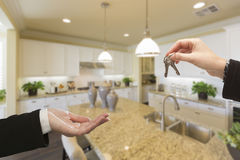 Handing Over New House Keys Inside Beautiful Kitchen Stock Images