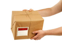 Handing Over The Package Royalty Free Stock Image