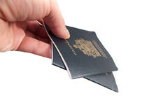 Handing over a pair of Canadian Passports royalty free stock photography