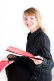 Handing over a red folder. A smiling attractive woman handing over a red folder Royalty Free Stock Photography