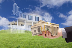Handing Over Thousands of Dollars with Ghosted House Drawing Beh Stock Photo