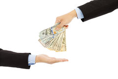Handing Over us dollar Cash to Other Hand. Isolated on a White Background Royalty Free Stock Photo