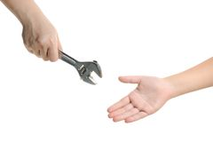 Handing over wrench Stock Photo