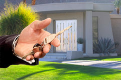 Handing Over your keys. Image of a beautiful Desert home in california as real Estate salesman Hands Over Keys Stock Images