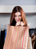 Handing paper bags Stock Photography