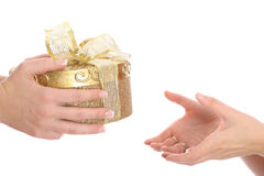 Handing a present. 2 isolated on white Stock Photography
