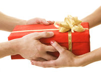 Handing a present. Cristmas celebrating Royalty Free Stock Photography