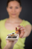 Handing reaching for cigarette in mousetrap Royalty Free Stock Photo
