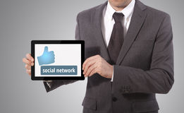 Handing social network tablet Royalty Free Stock Images