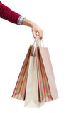 Handing some stripped paper bags Stock Photography