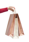 Handing three paper bags Stock Photography