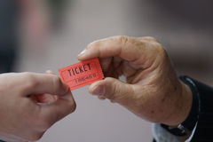 Handing tickets Royalty Free Stock Image
