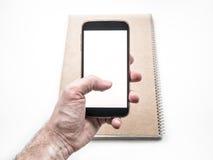 Handinnehav och använda den mobila smartphonemodellen Arkivbilder