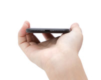 Handinnehavtelefonen som visar usb-port, förbinder på vit Royaltyfri Fotografi