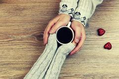 Handkaffee-Hintergrundpaare Stockbilder