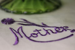 Handkerchief Embroidered with Mother. White handkerchief embroidered with mother written in purple thread Stock Photography