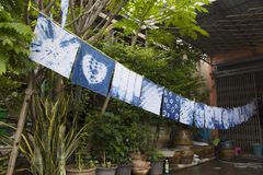 Handkerchief tie batik dyeing tie batik indigo color. Or mauhom color and hanging process dry clothes in the sun at garden outdoor in Nonthaburi, Thailand royalty free stock photos