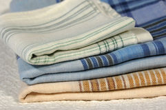 Handkerchiefs. Three freshly washed and ironed colorful old cotton pocket handkerchiefs stock photos
