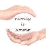 Handkonzept für Geld ist- Energie Stockbilder