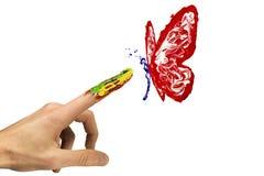 Handlag mellan fingret och den målade röda fjärilen stock illustrationer