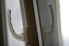 Handle. A silver handle with pvc brown door Stock Images