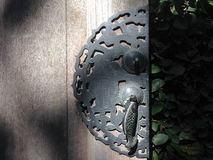 Handle ancient Perforated metal door knocker. Royalty Free Stock Photos
