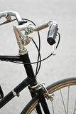 Handle bar of a black bicycle with black grip Royalty Free Stock Photo