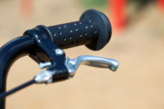 Handle of a bike with the brake lever stock image