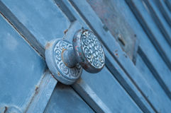 Handle on blue metals door. Closeup on handle on blue metals door Royalty Free Stock Photos