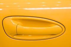 Handle of car door. Handle of orange car door Stock Images