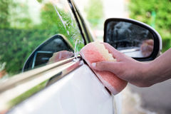 Handle car wash concept - male hand with sponge. Handle car wash concept - male hand with soap sponge Stock Image