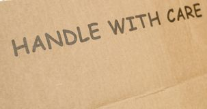 Handle with care. Cardboard box clearly marked handle with care Stock Photo