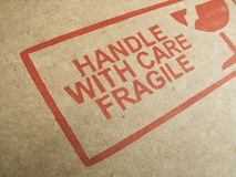 Handle With Care!. Image of caution print on the side of cardboard Stock Photography