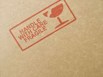 Handle With Care!. Image of caution print on the side of cardboard Royalty Free Stock Photo