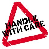 Handle with care rubber stamp Stock Photo