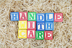 Handle With Care Spelled Out by Blocks Royalty Free Stock Image