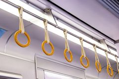 The handle on on ceiling of sky train, underground railway syste Royalty Free Stock Photography